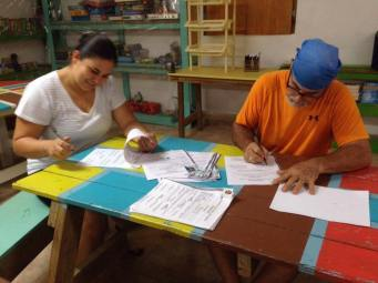 ivonne and ronnie signing soccer papers